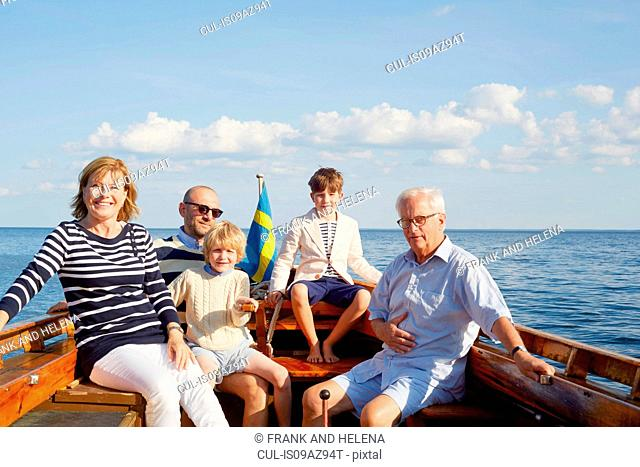 Family on boat looking at camera smiling