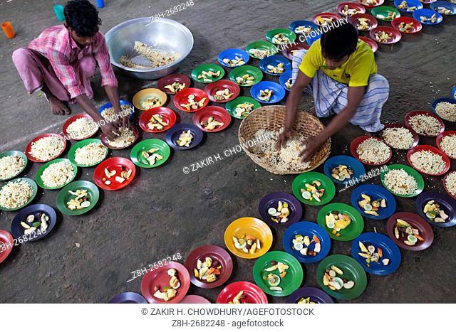 DHAKA, BANGLADESH - JUNE 11 : Homeless people take ifter food during Ramdan at the High Court Mazar premises adjacent to theInternational Crimes Tribunal of Old...