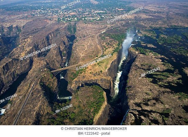 Helicopter flying above Victoria Falls, railway bridge, Zambia, Zimbabwe, Africa