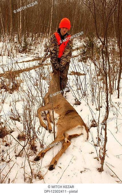 Youth Hunter With First Deer Dragging In Field