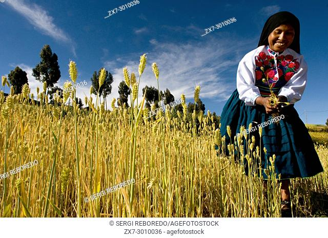 A woman from the island of Amantaní dressed in her typical regional costume. Amantani Island, Lake Titicaca, Puno, Peru