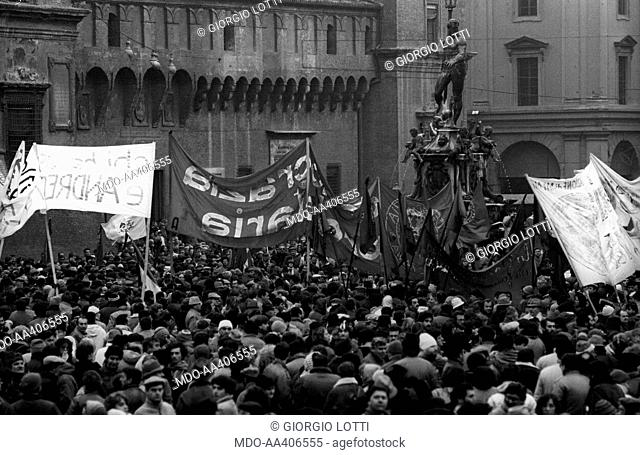 A demonstration in Piazza Nettuno for the victims of the Train 904 bombing. A crowd of people holding some banners around the Fountain of Neptune