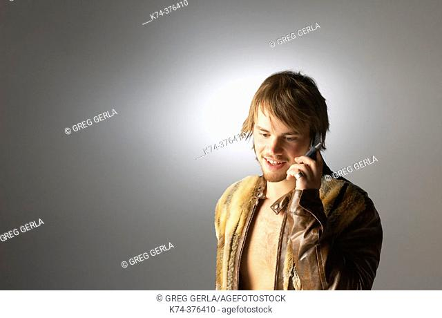 Young man talking on cellular telephone