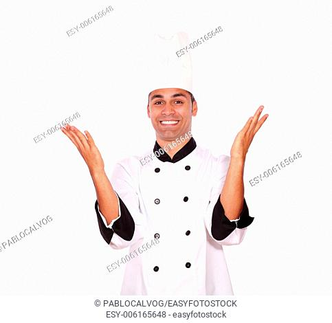 Portrait of an excited male chef standing with hands up on white background