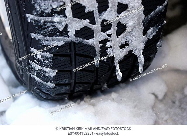 Bitterly cold weather, icicles on the tyre