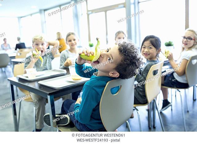 Pupils having lunch in school canteen