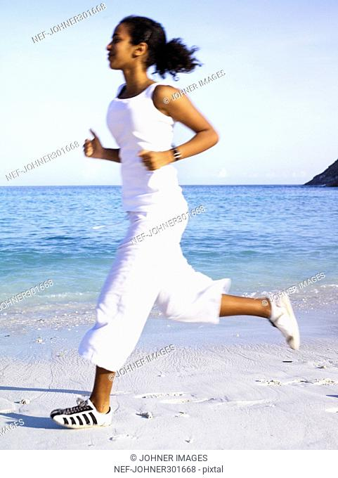 A woman jogging on a beach