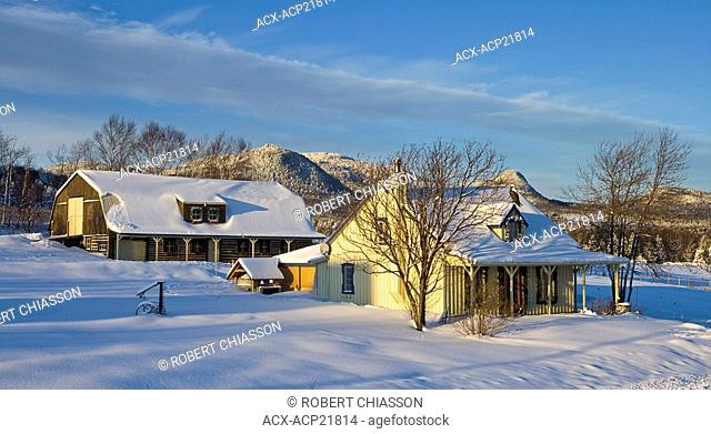 Home and barn at the foot of mont des Ìĉۡboulements in Charlevoix, Quebec, Canada