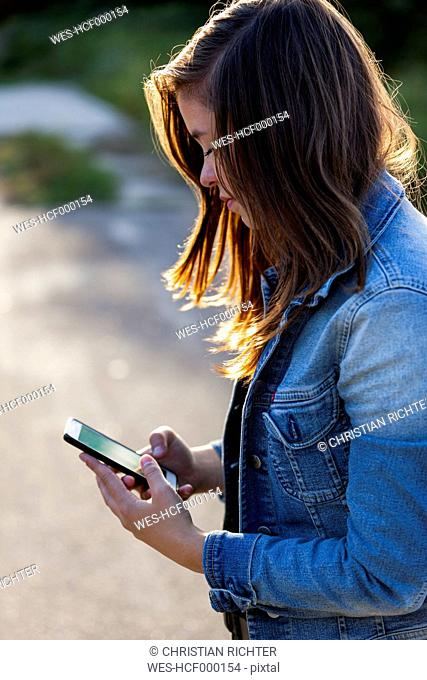 Teenage girl looking at smartphone