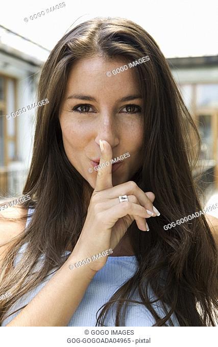 """Woman making """"shh"""" motion"""
