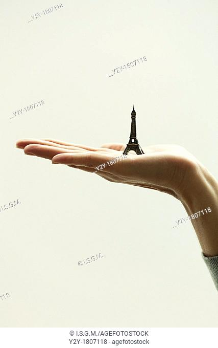 Girl`s hand with Eiffel Tower