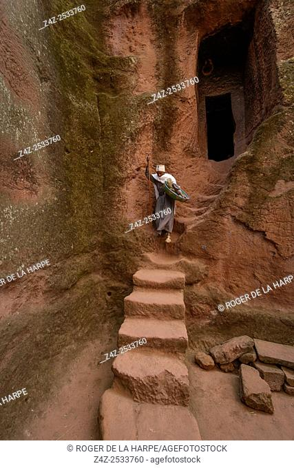 Woman on stairs at Bet (or Biete) Ammanuel ( House of Emmanuel). Rock Hewn Churche of Lalibela. Ethiopia