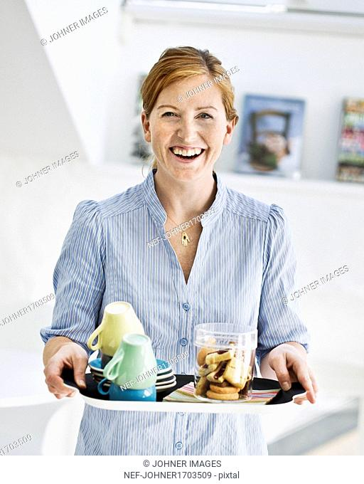 Smiling woman with tray