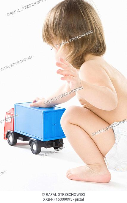 baby girl playing with truck