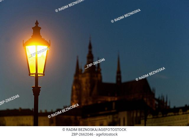 Evening atmosphere lit the lamp with the background Prague Castle, Prague, Czech Republic