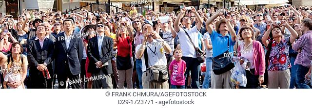 cezch republic, prague - tourists watching astronomical clock at old town square
