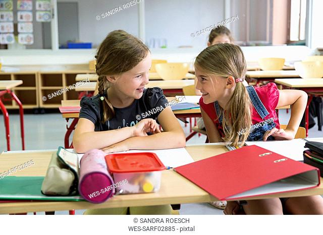 Two schoolgirls at class