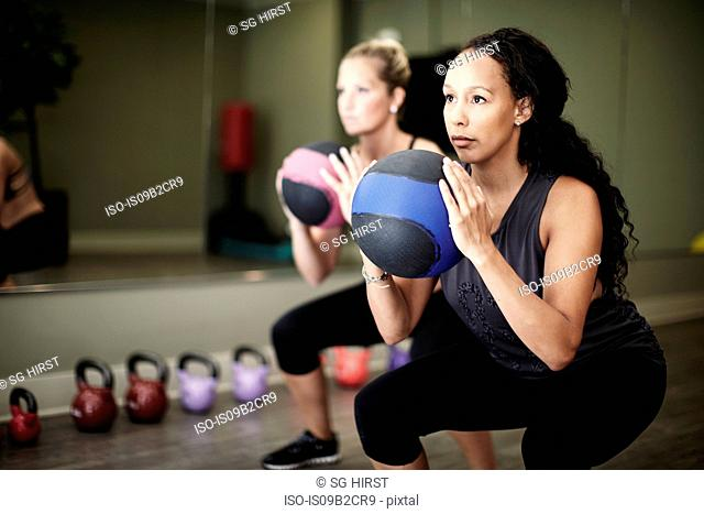 Women working out with gym ball in gym