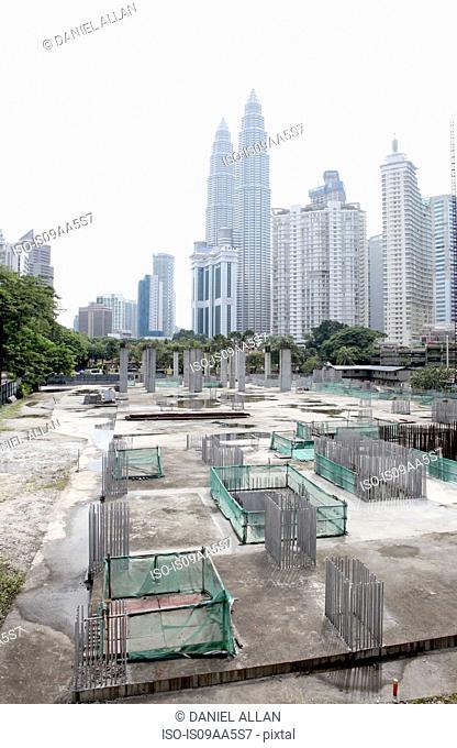 Petronas Towers overlooking building site, Kuala Lumpur , Malaysia