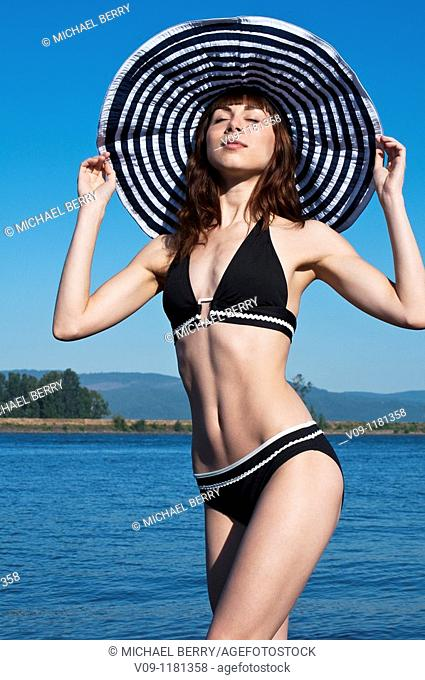Woman in bikini with a hat, Columbia River, USA