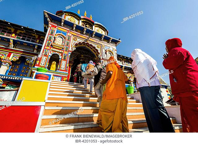 Pilgrims entering the colourful Badrinath Temple, one of the Dschar Dham destinations, Badrinath, Uttarakhand, India