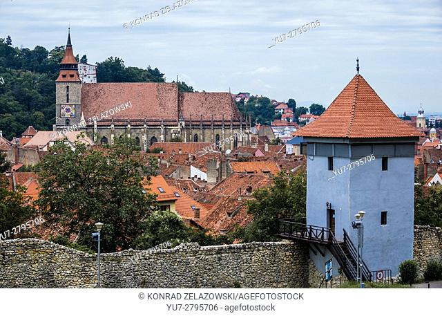 Black Church (Romanian - Biserica Neagra) and one of the fortified towers in Brasov, Romania. White Tower on background