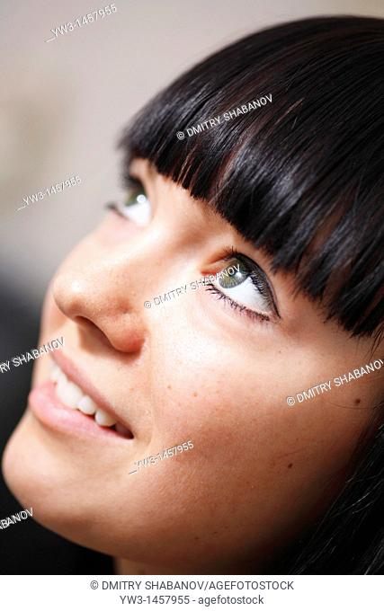 face of the girl looking upwards closeup shot