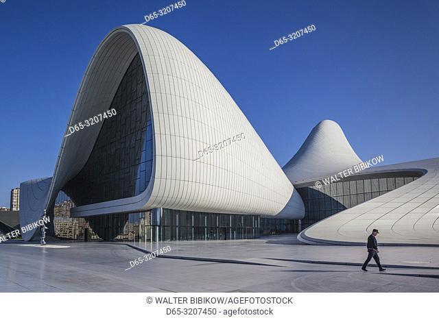 Azerbaijan, Baku, Heydar Aliyev Cultural Center, building designed by Zaha Hadid, exterior with visitors, NR
