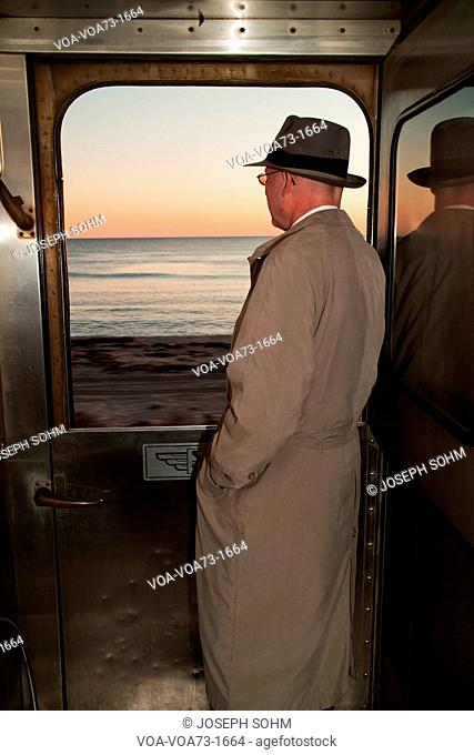 1940's reenactor looks out of window on Pearl Harbor Day Troop train reenactment from Los Angeles Union Station to San Diego