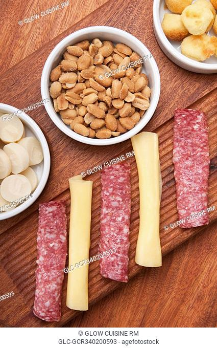 High angle view of ham and cheese rolls served with nuts and fruit