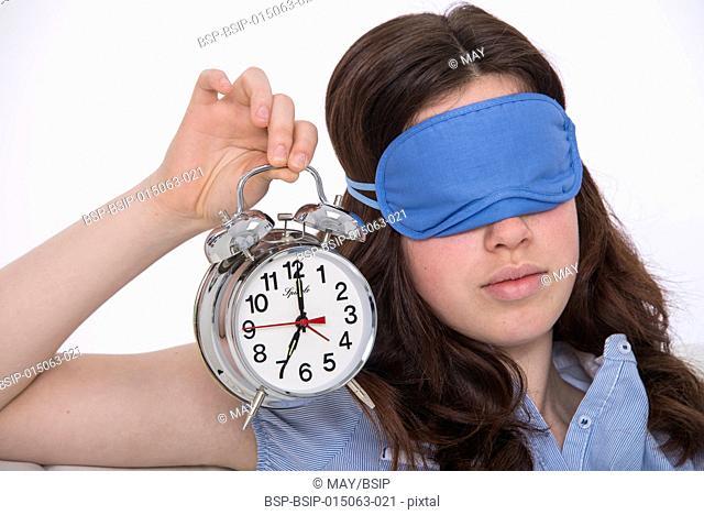 Girl holding an alarm clock