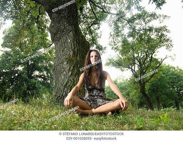 Beautiful young woman sitting under a tree  Taken in Lipica, Slovenia  Concept: teenagers and nature, nature love