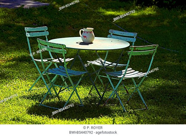 garden chairs and table on a lawn, France, Savoie, Tarentaise, Sainte Foy