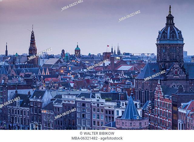 Netherlands, Amsterdam, elevated city skyline with the St-Nicholaskerk church, dusk