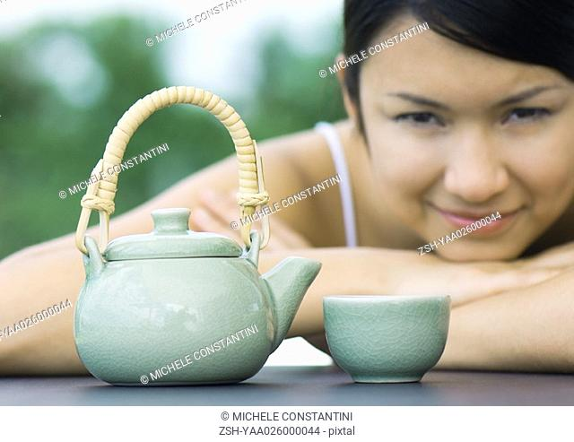 Woman with teapot and teacup