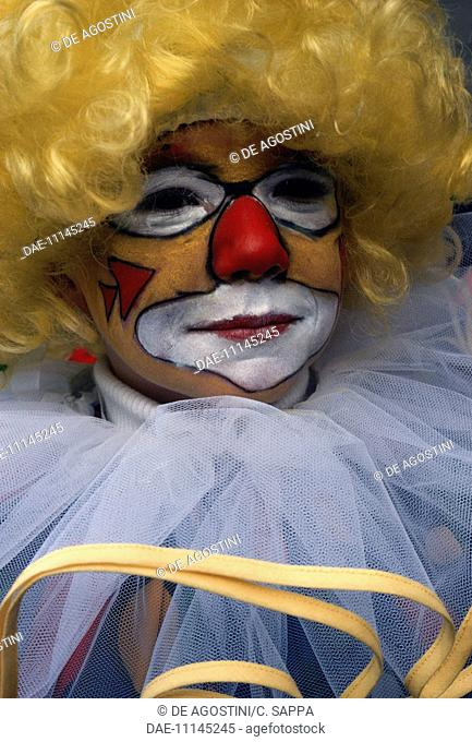 Child with painted face dressed as a clown, Carnival of Binche (UNESCO Intangible Cultural Heritage, 2008), Hainaut, Belgium