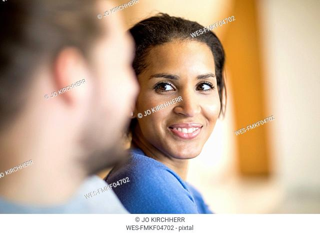 Portrait of happy young woman in love