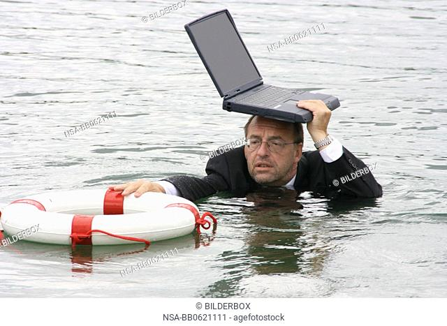manager stands in deep water