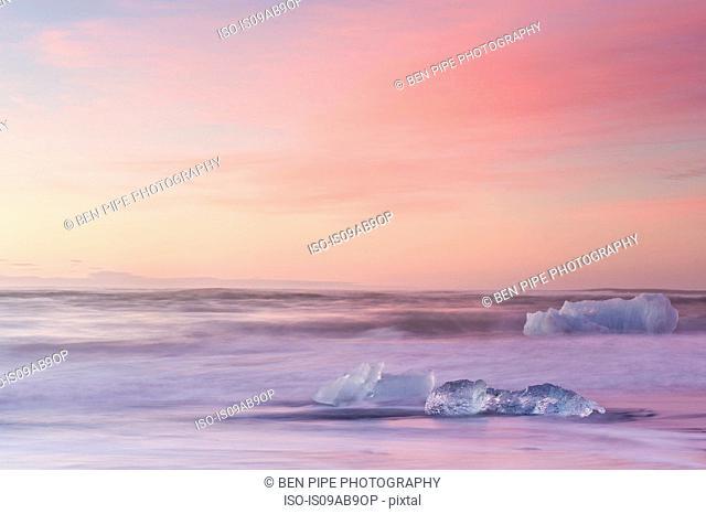 Icebergs on beach at dusk, Jokulsarlon, Iceland