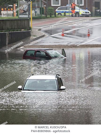 Cars can be seen in a flooded underpass in Oberhausen,Germany, 30 May 2016. Photo:MARCELKUSCH/dpa | usage worldwide. - Oberhausen/North...