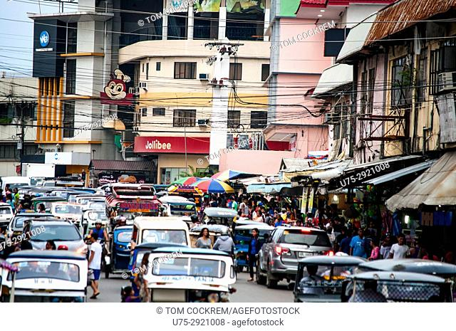 Street scene with tricycle taxis, Malvar Road, Puerto Princesa, Palawan, Philippines