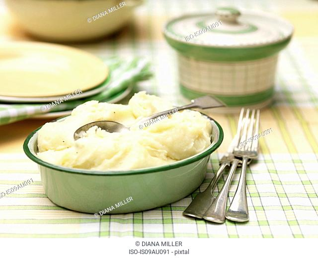 Cheddar cheese mashed potatoes in green vintage tin