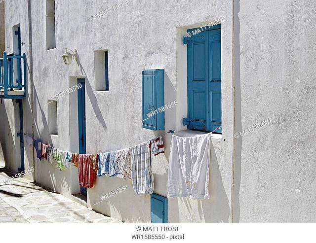 Hanging out the washing in Mykonos Town (Chora), Mykonos, Cyclades, Greek Islands, Greece, Europe