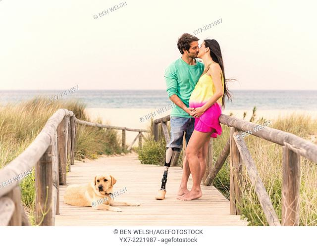 Disabled man with pregnant woman and there labrador. Tarifa, Cadiz, Andalusia, Spain, Europe