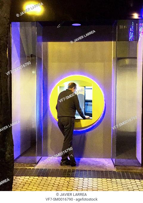 man in a bank ATM