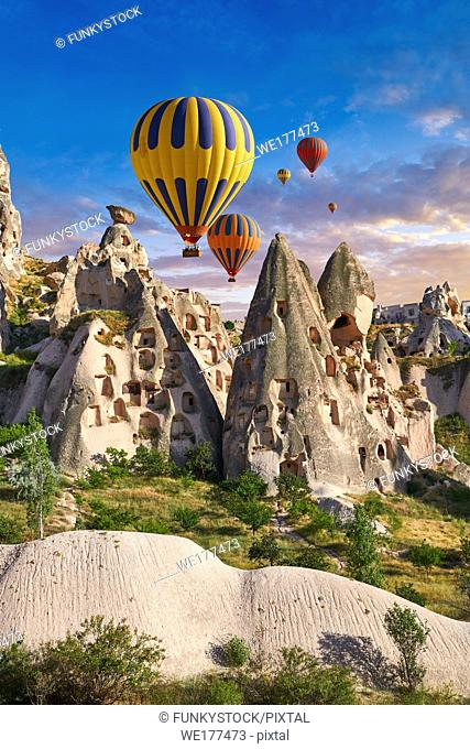 Pictures & images of hot air balloons over Uchisar Castle & the cave city houses in the rock formations & fairy chimney of Uchisar, near Goreme, Cappadocia