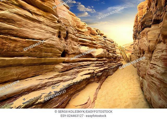 Sandy canyon in desert of Sinai at sunset