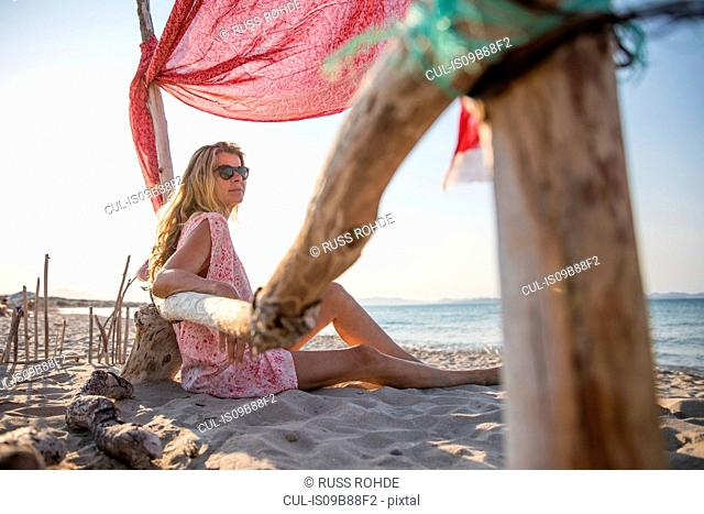 Woman sitting on beach relaxing, Palma de Mallorca, Islas Baleares, Spain, Europe