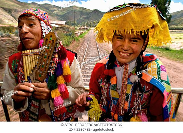 Andean Explorer, luxury train from Cusco to Puno. Train inside. Musicians and dancers in traditional costumes ride on beautify the Andean Explorer train Orient...