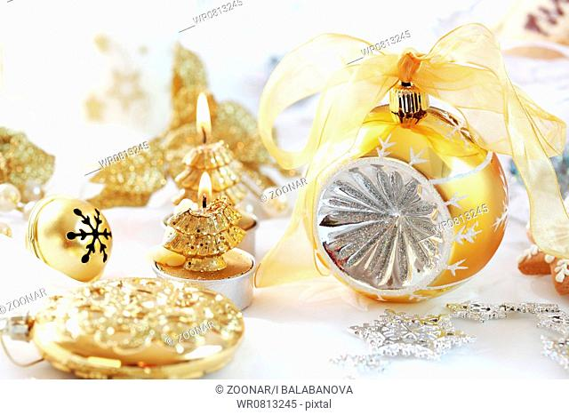 Christmas decoration with ball and candles in golden tone